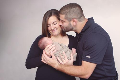 Kansas City Newborn Photographer | Mom and Dad holding newborn baby girl