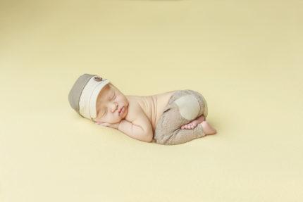 Kansas City Newborn Photographer | Baby boy on yellow background in hat