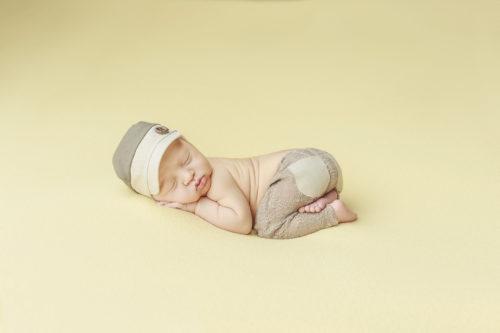 Kansas City Newborn Photographer   Baby boy on yellow background in hat
