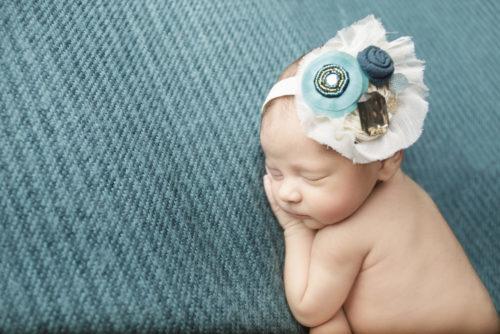 kansas city newborn photography   picture of newborn girl on turquoise backdrop