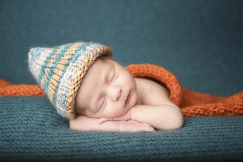 Kansas City Newborn Photographer | newborn baby girl in white pants and ribbon