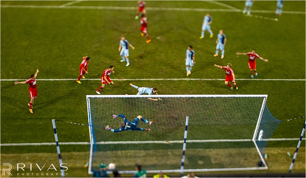 March 15, 2014: Matt Hedges #24 of FC Dallas shoots past Matt Besler #5 of Sporting KC in the second half during the MLS game on March 15, 2014 at Sporting Park in Kansas City, Kansas.