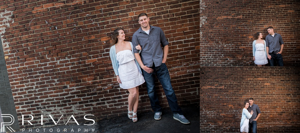 Schwinn Produce Farm Sunflower Engagement Pictures | Three candid pictures of an engaged couple standing in front of a brick wall in Kansas City's River Market.