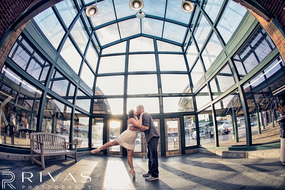 Schwinn Produce Farm Sunflower Engagement Pictures | A candid photo of an engaged couple doing ballet dance moves.