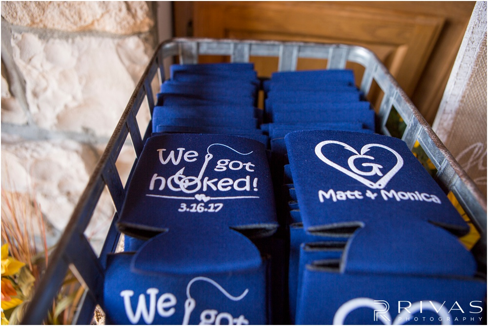 Lake of the Ozarks Elopement | Close-up of photo of custom-made wedding favor koozies on display at a lake house.