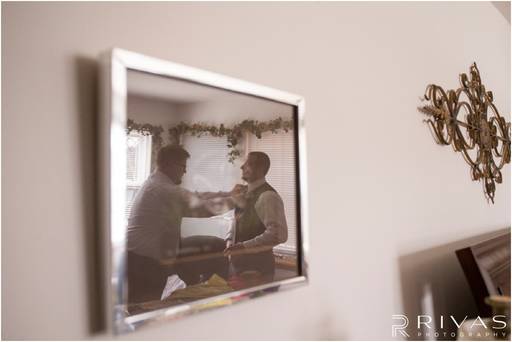 Lake of the Ozarks Elopement | A photo of a groom getting dressed on his wedding day.
