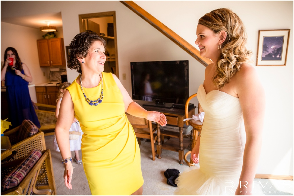 Lake of the Ozarks Elopement | A candid photo of a mom seeing her daughter in her wedding dress on her wedding day.
