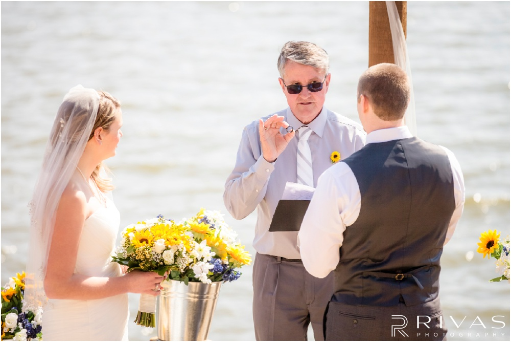 Lake of the Ozarks Elopement | A photo of a bride and groom exchanging rings during their lakeside elopement.