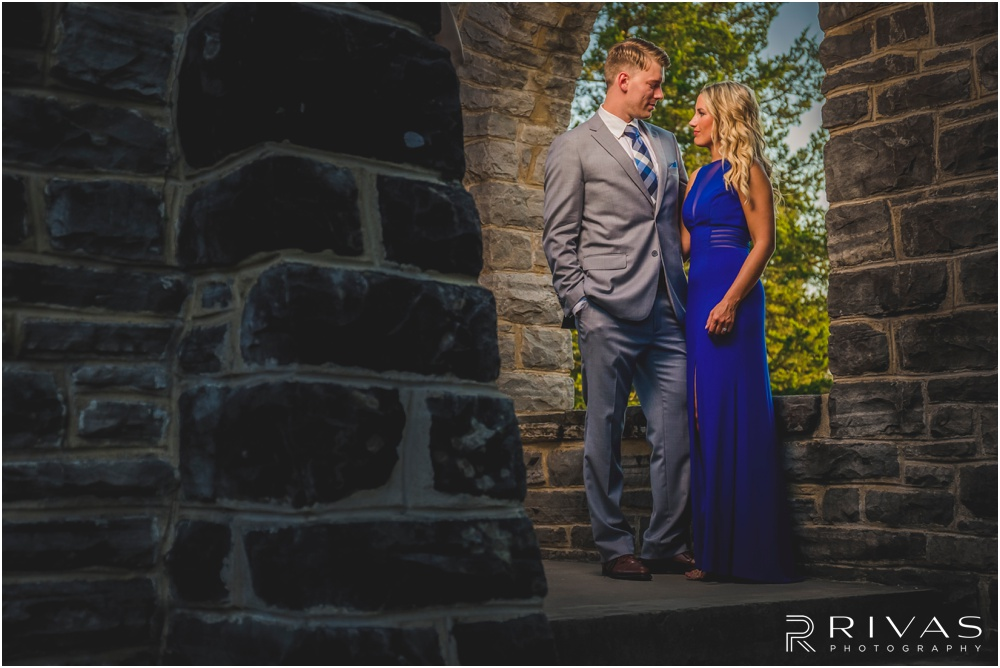 romantic castle ruins engagement pictures | A picture of an engaged couple holding hands at the top of a flight of stairs.