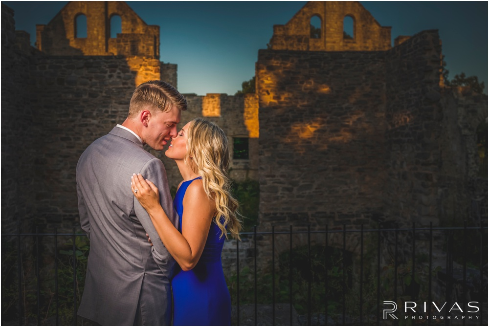 romantic castle ruins engagement pictures | A close-up picture of an engaged couple embracing outside castle ruins.