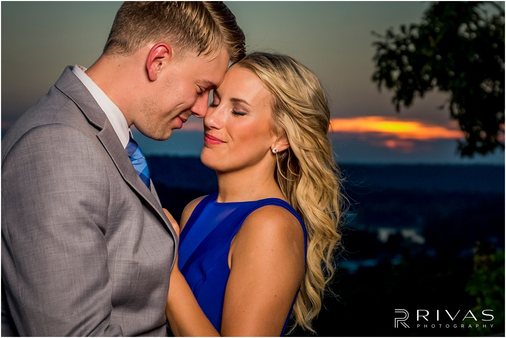 romantic castle ruins engagement pictures | A photo of an engaged couple embracing overlooking the Lake of the Ozarks at sunset.