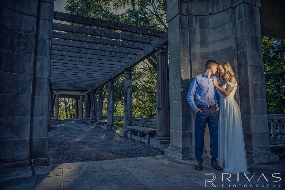 Kayla & James Engagement Session Sneak Peek | An intimate picture of a dressed up engaged couple standing at The Colonnade in Northeast Kansas City.