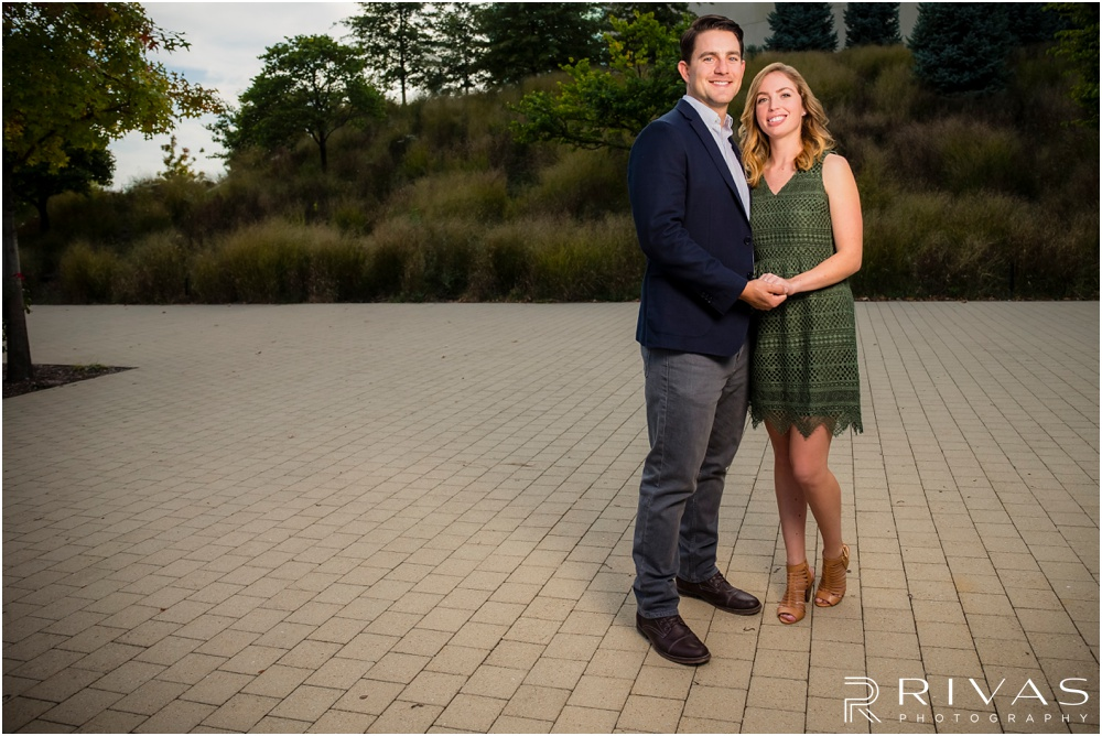 Elegant Kauffman Center Engagement Pictures | A picture of a dressed up engaged couple holding hands near the Kauffman Center for the Performing Arts.