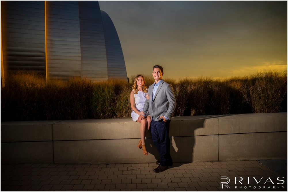 Elegant Kauffman Center Engagement Pictures | A photo of a dressed up engaged couple on the north side of the Kauffman Center for the Performing Arts.