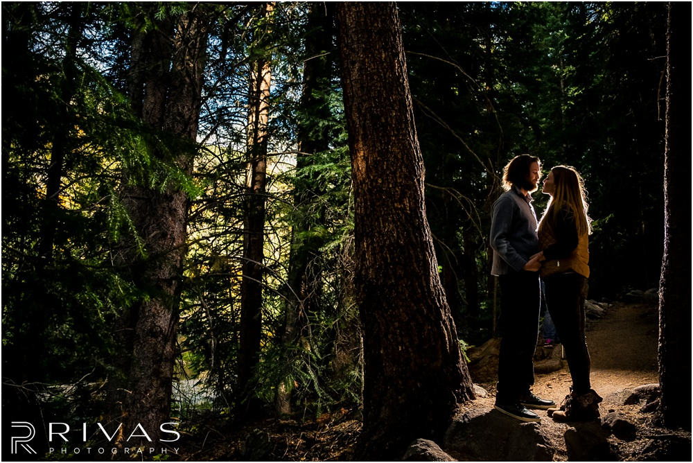 Fall Aspen Engagement Session | A photo of a couple standing on a trail at a roadside park outside Aspen, Colorado.