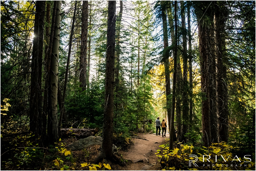 Fall Aspen Engagement Session | A photo of an engaged couple walking on a trail at a roadside park outside Aspen, Colorado.