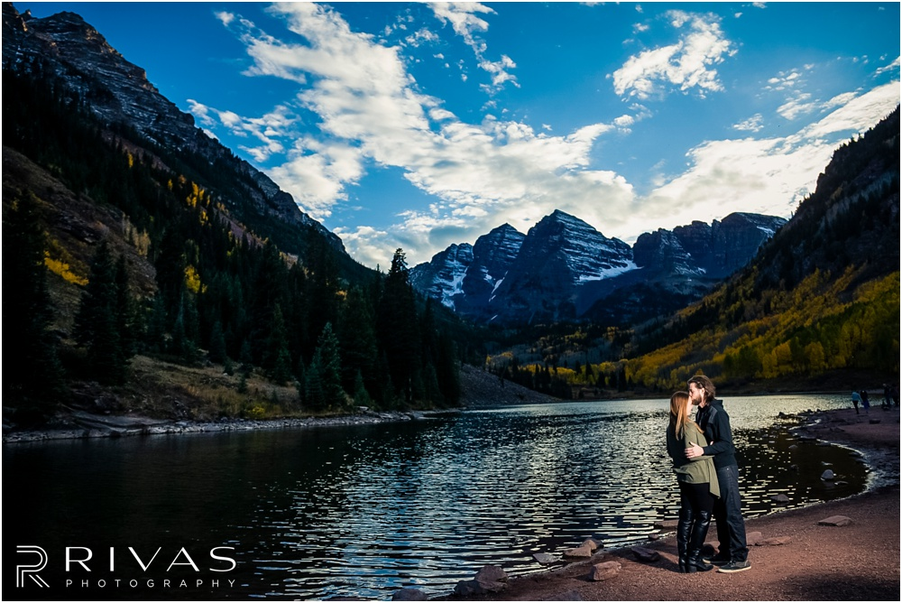 Fall Aspen Engagement Session | A picture of an engaged couple in fall sweaters by the lake at Maroon Bells near Aspen, Colorado.