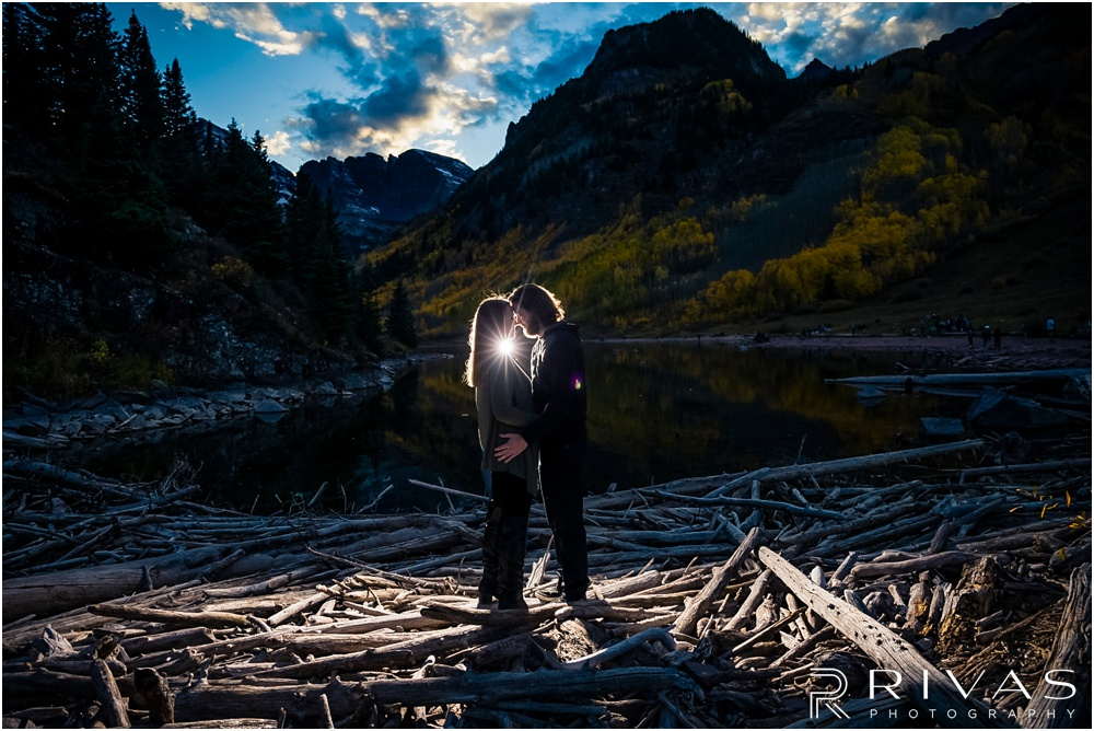 Fall Aspen Engagement Session | A photo of an engaged couple in fall sweaters by the lake at Maroon Bells near Aspen, Colorado.