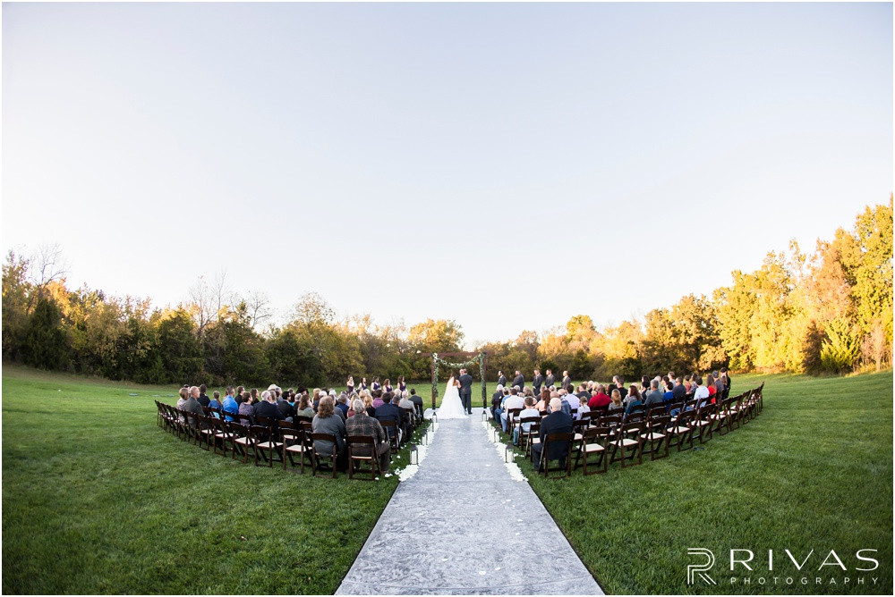 elegant fall wedding buffalo lodge | A picture of the entire ceremony set-up from a sunset wedding at The Buffalo Lodge.