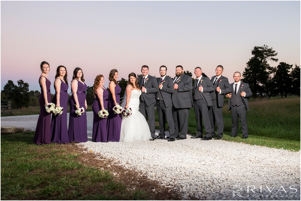 elegant fall wedding buffalo lodge | A picture of a bride and groom with their wedding party at The Buffalo Lodge.