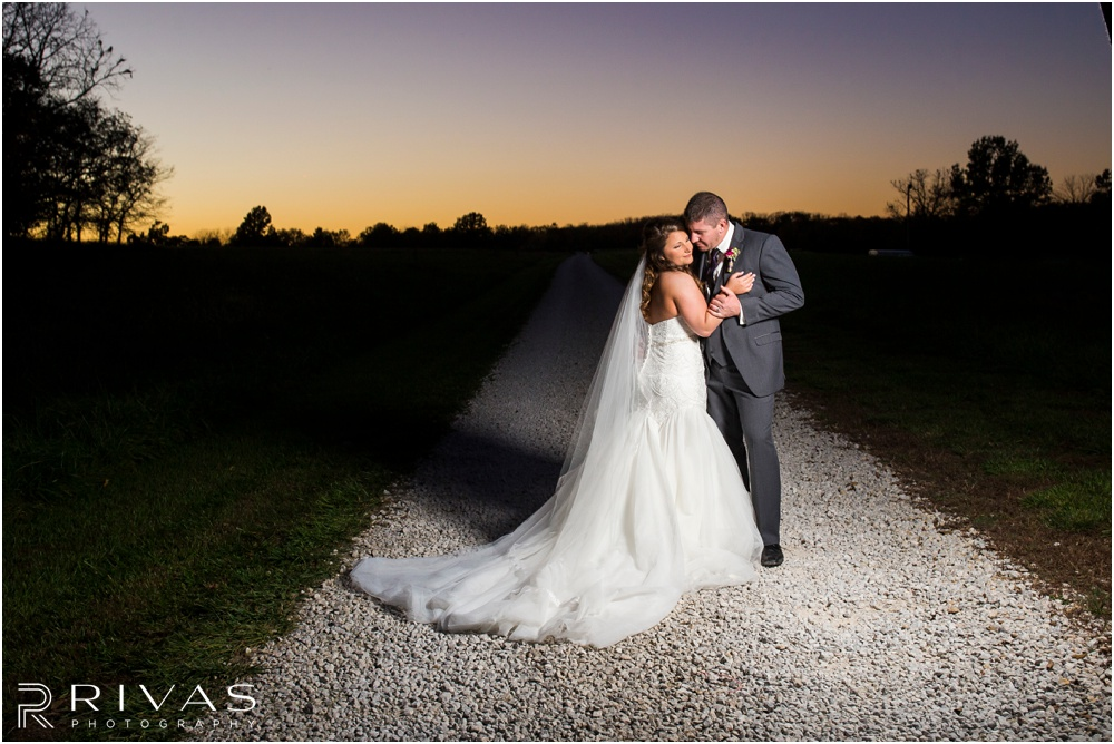 elegant fall wedding buffalo lodge | A photo of a bride and groom hugging at sunset at The Buffalo Lodge.