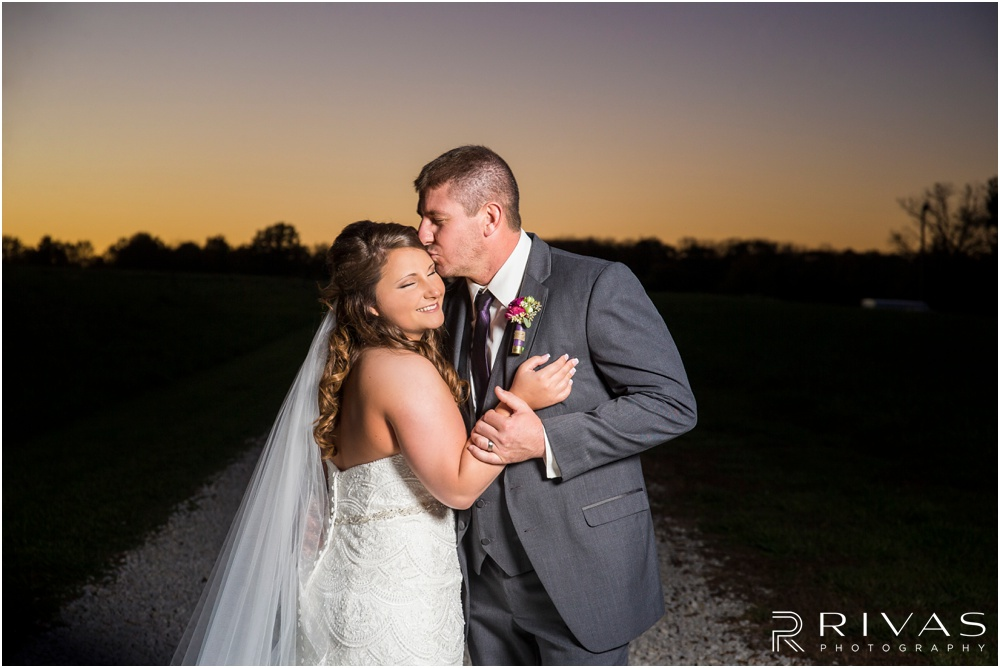 elegant fall wedding buffalo lodge | A close-up photo of a bride and groom hugging at sunset at The Buffalo Lodge.