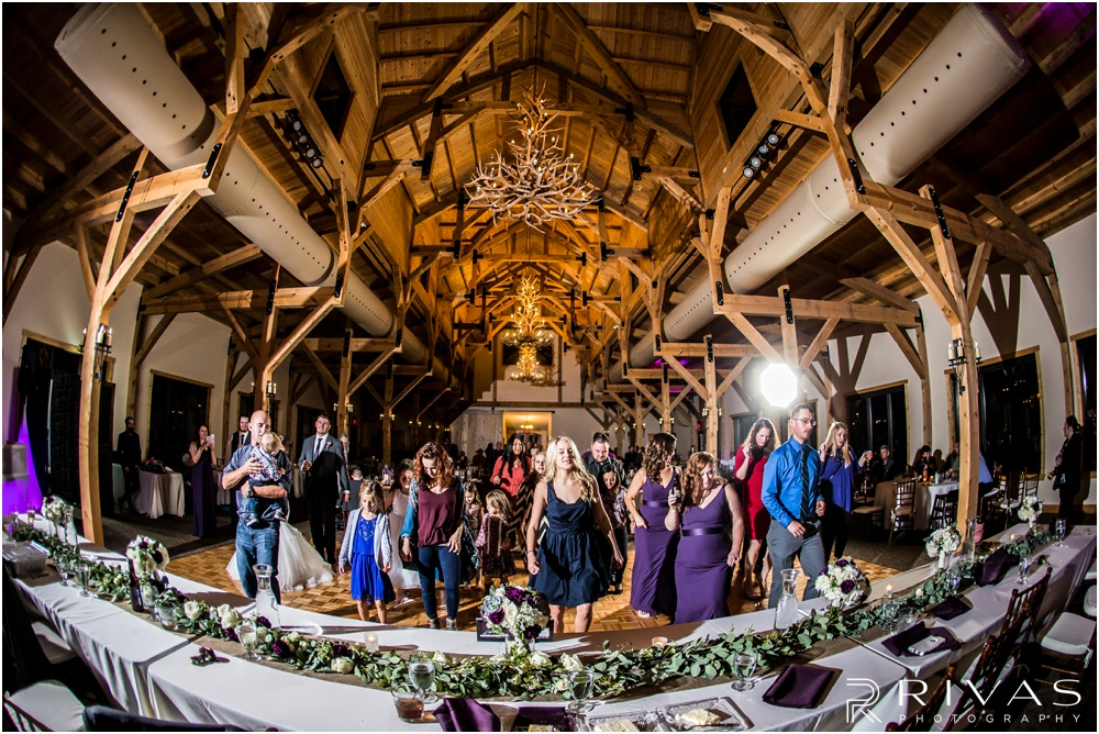 elegant fall wedding buffalo lodge | A picture of guests at a wedding reception dancing at The Buffalo Lodge.