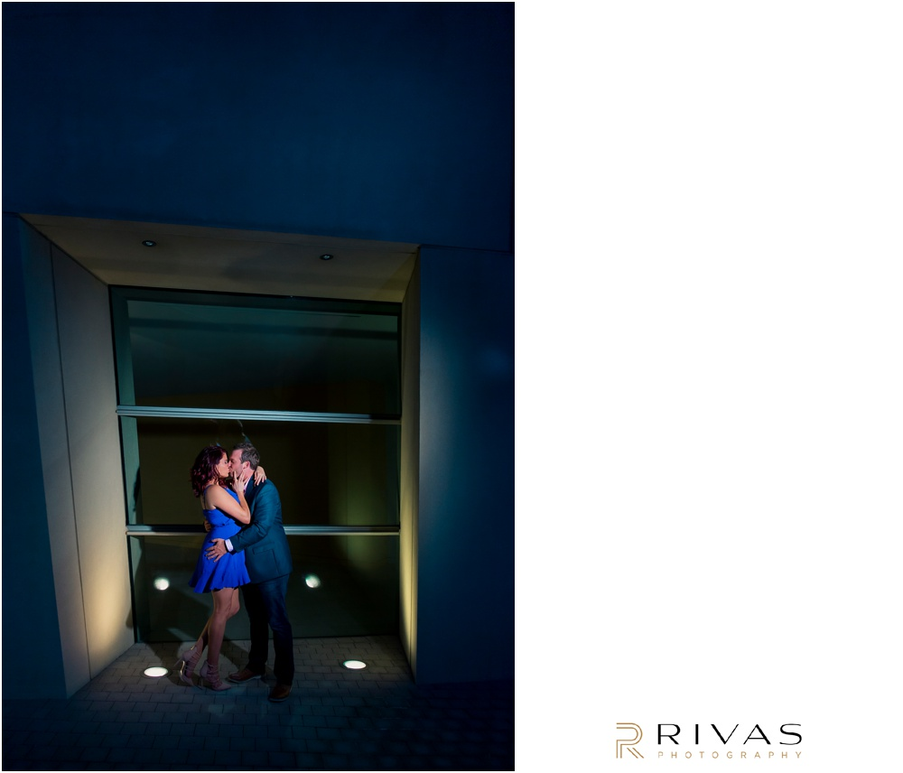 Kauffman Center Engagement Sneak Peek | Photo of an engaged couple kissing in an archway at Kauffman Center for the Performing Arts.