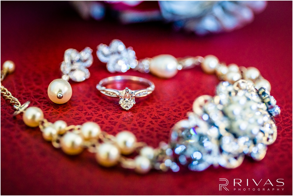 KC Winter Wedding | A close-up picture of a bride's engagement ring and wedding day earrings and necklace.