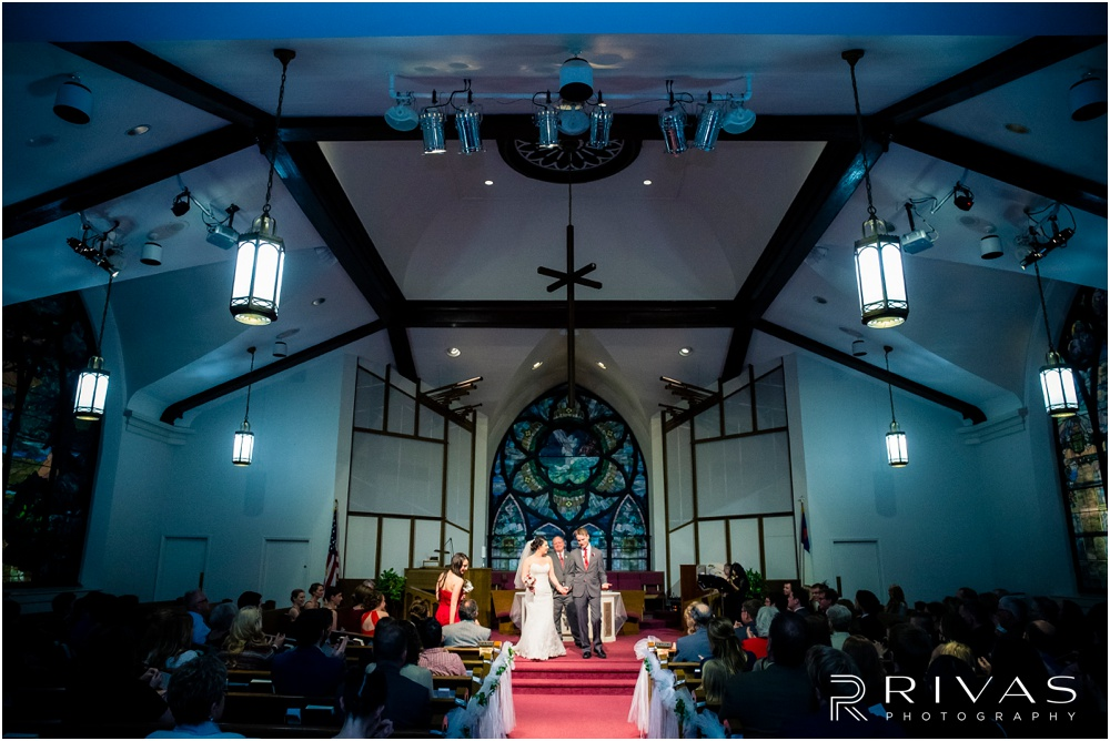KC Winter Wedding | A picture of a bride and groom walking back down the aisle after their wedding ceremony.