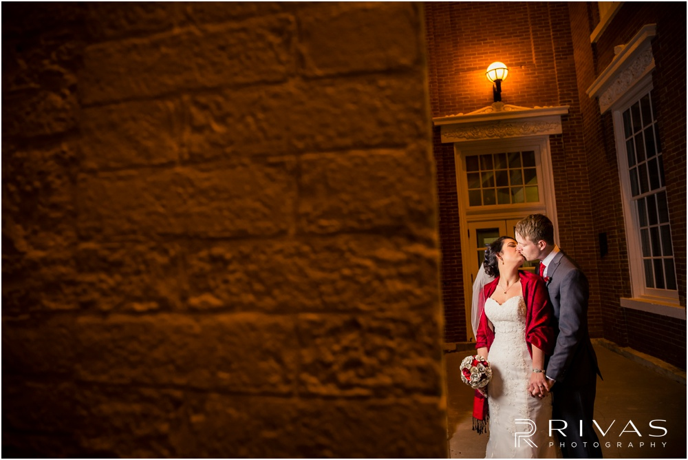 KC Winter Wedding | A nighttime picture of a bride and groom kissing at William Jewell College.