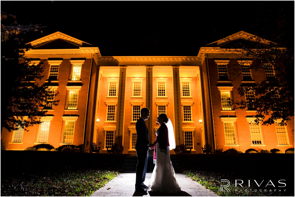 KC Winter Wedding | A silhouette image of a bride and groom at night at William Jewell College.