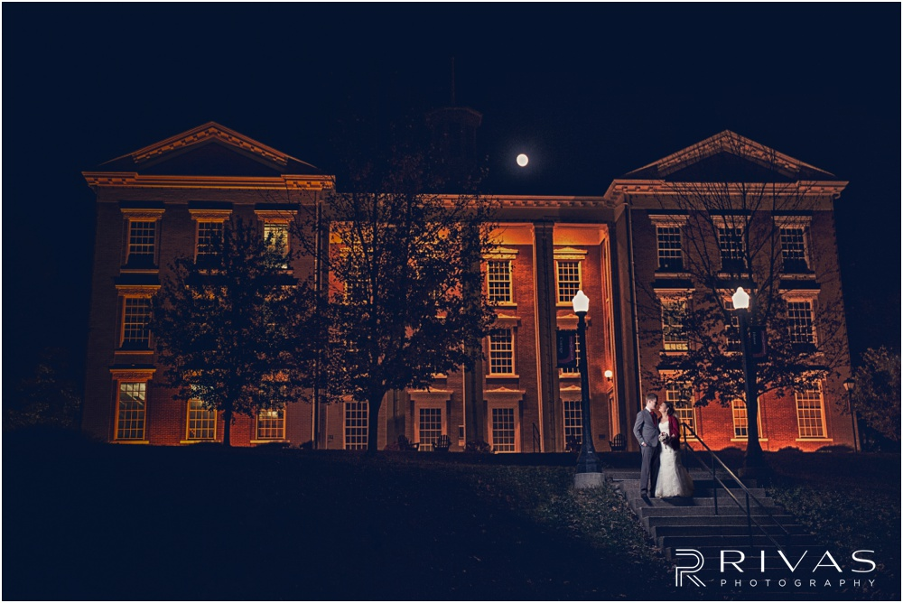 KC Winter Wedding | A nighttime image of a bride and groom embracing at William Jewell College.