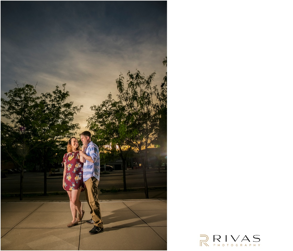 Summertime Crossroads Engagement Session | Picture of an engaged couple on the west side of the Kansas City Star Building.
