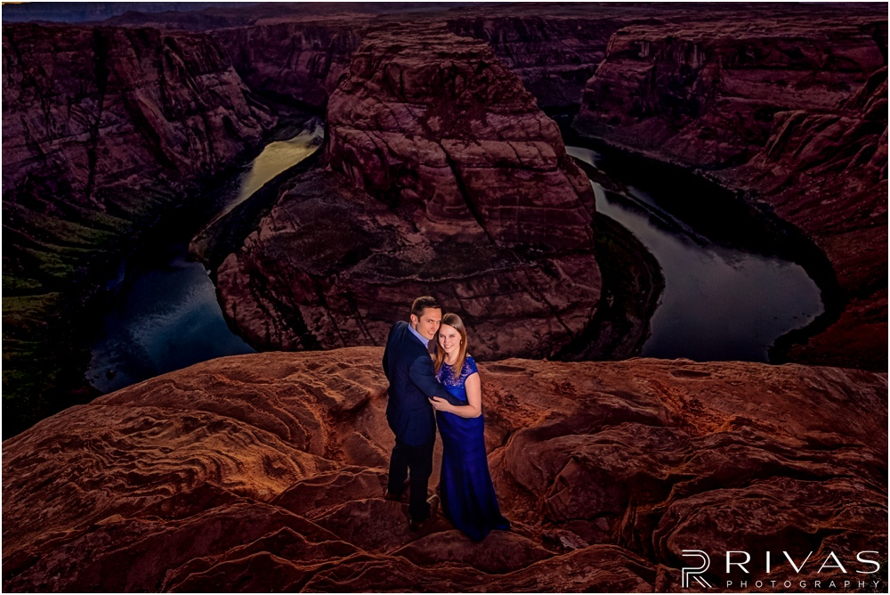 Merry-Go-Round Rock Engagement Session | Picture of a dressed up engaged couple overlooking Horseshoe Bend in Page Arizona.