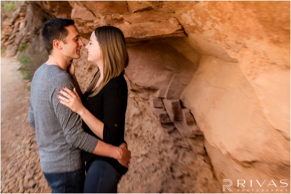 Merry-Go-Round Rock Engagement Session | Picture of an engaged couple standing in front of red rocks in Sedona.