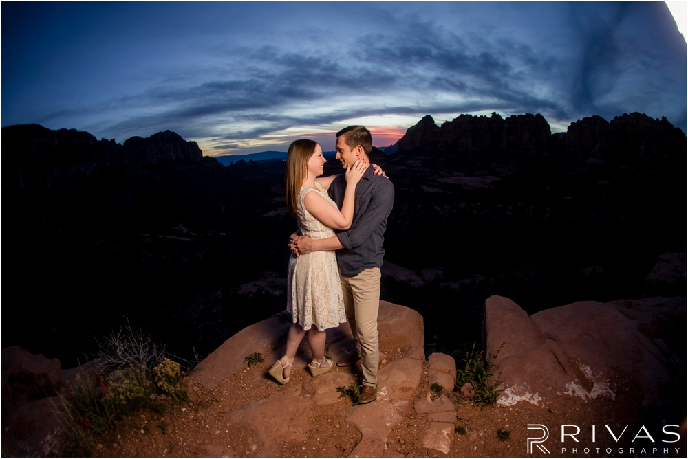 Merry-Go-Round Rock Engagement Session | Close-up photo of an engaged couple standing on Merry-Go-Round Rock at sunset in Sedona.