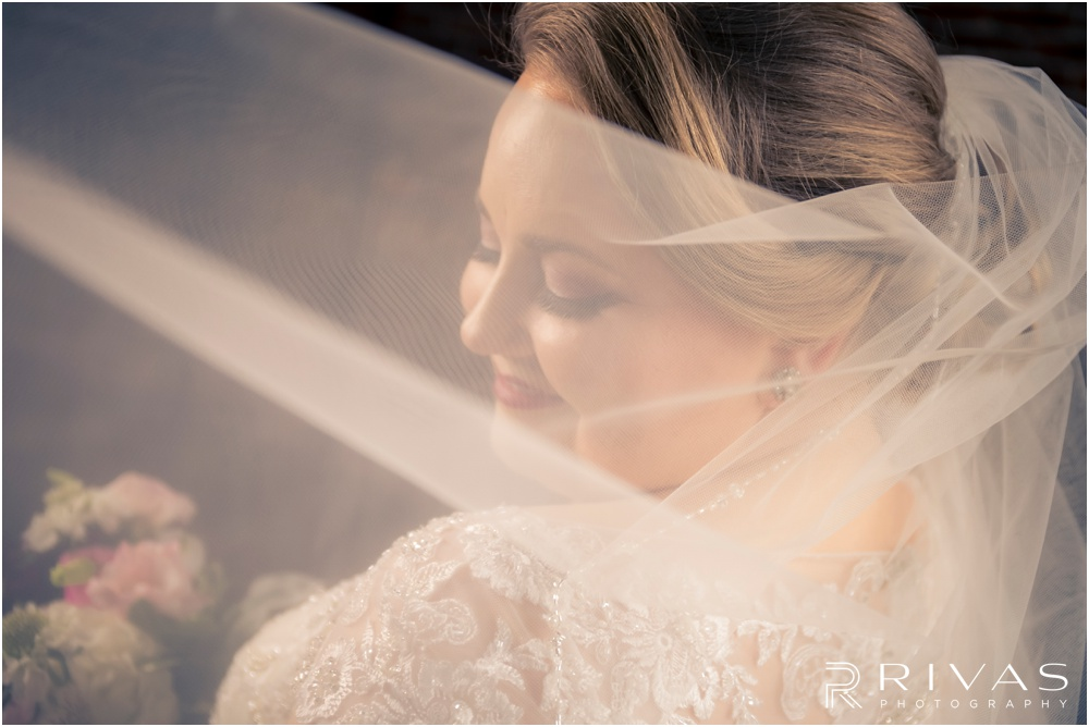 Vibrant Spring Wedding at The Guild | A close-up picture of a bride smiling in her wedding gown and veil at The Guild KC.
