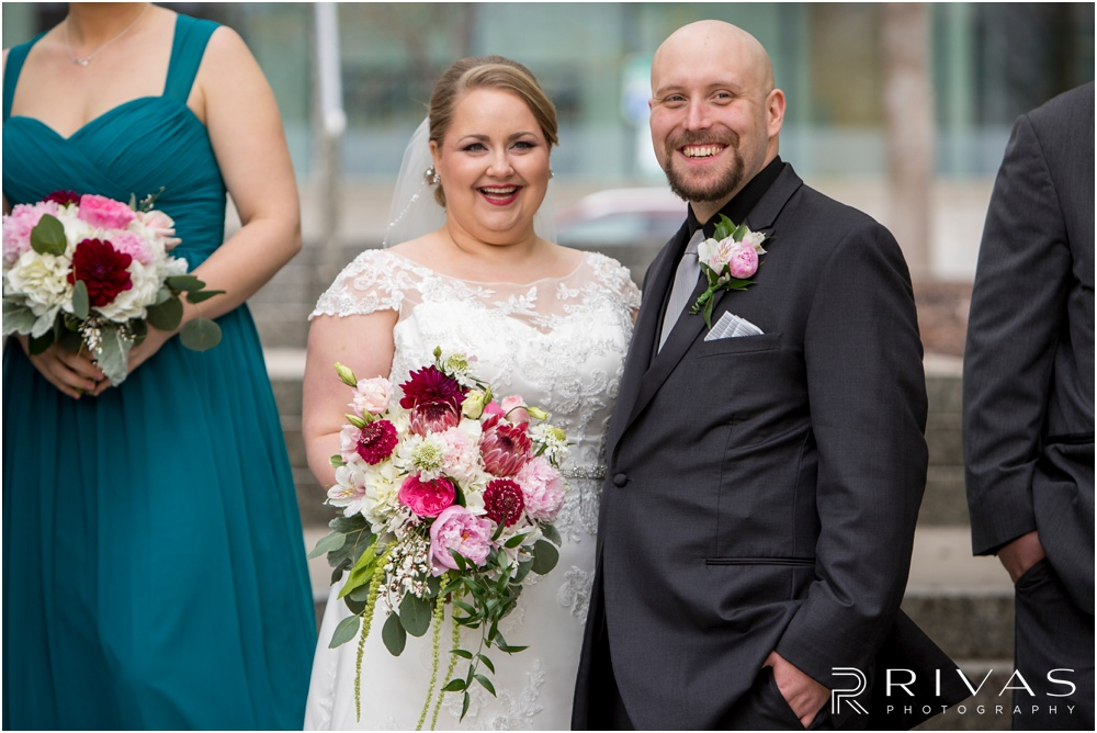 Vibrant Spring Wedding at The Guild | A candid picture of a bride and groom with their wedding party at Ilus Davis Park in Kansas City.