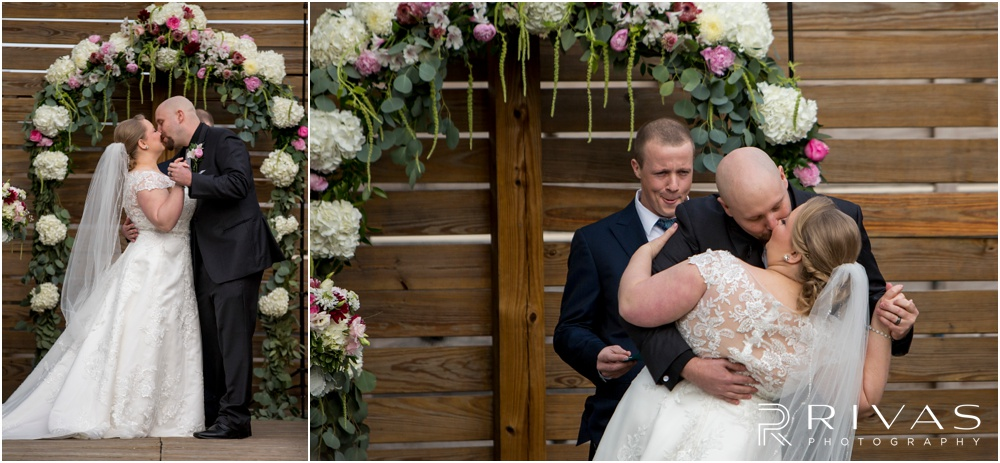 Vibrant Spring Wedding at The Guild | A bride and groom sharing their first kiss at the end of their wedding ceremony in the courtyard at The Guild KC.