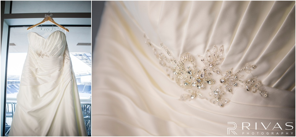 children's mercy park winter wedding | Two pictures of a brides dress and beaded detail hanging in the window of a soccer stadium.