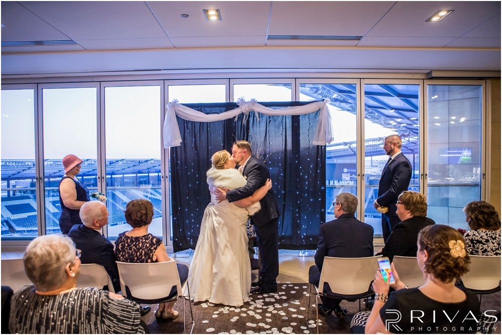 children's mercy park winter wedding | An photo of a bride and groom sharing their first kiss as man and wife at Children's Mercy Park.