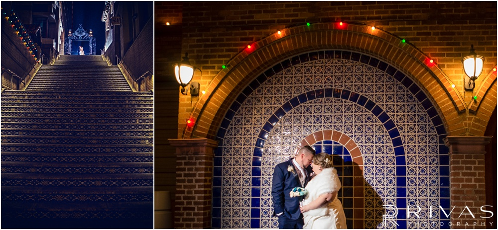 children's mercy park winter wedding | Two dramatic image of a bride and groom at the top of the infamous Plaza stairs and in front of the blue tile surrounded by Christmas lights.