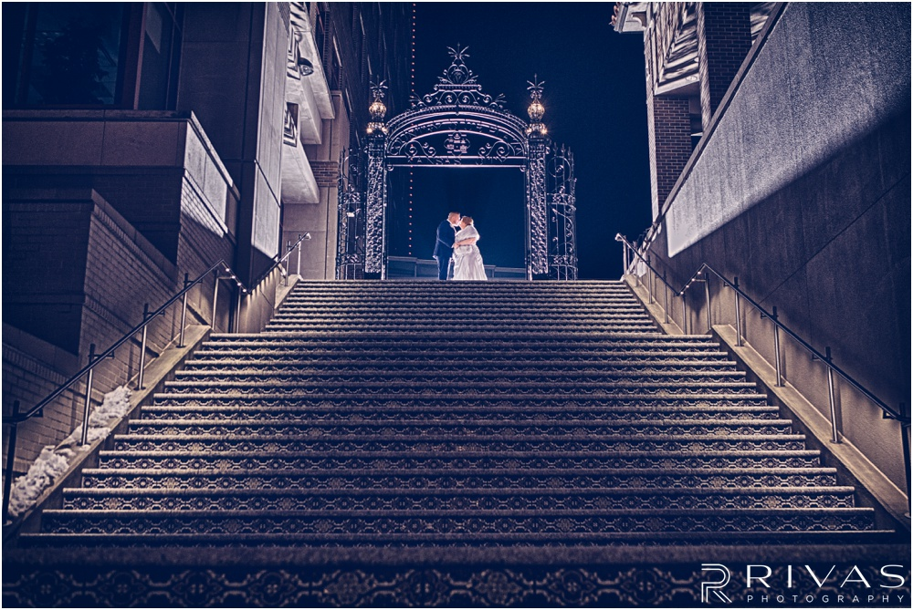 children's mercy park winter wedding | A picture of a bride and groom at the top of the the Plaza stairs in Kansas City.