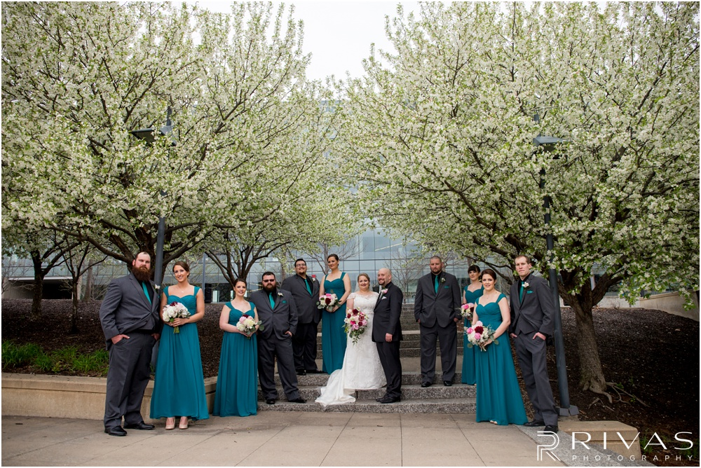 Wedding Day Timeline | Photo of a bridal party in turquoise and charcoal gray on a wedding day in downtown Kansas City.
