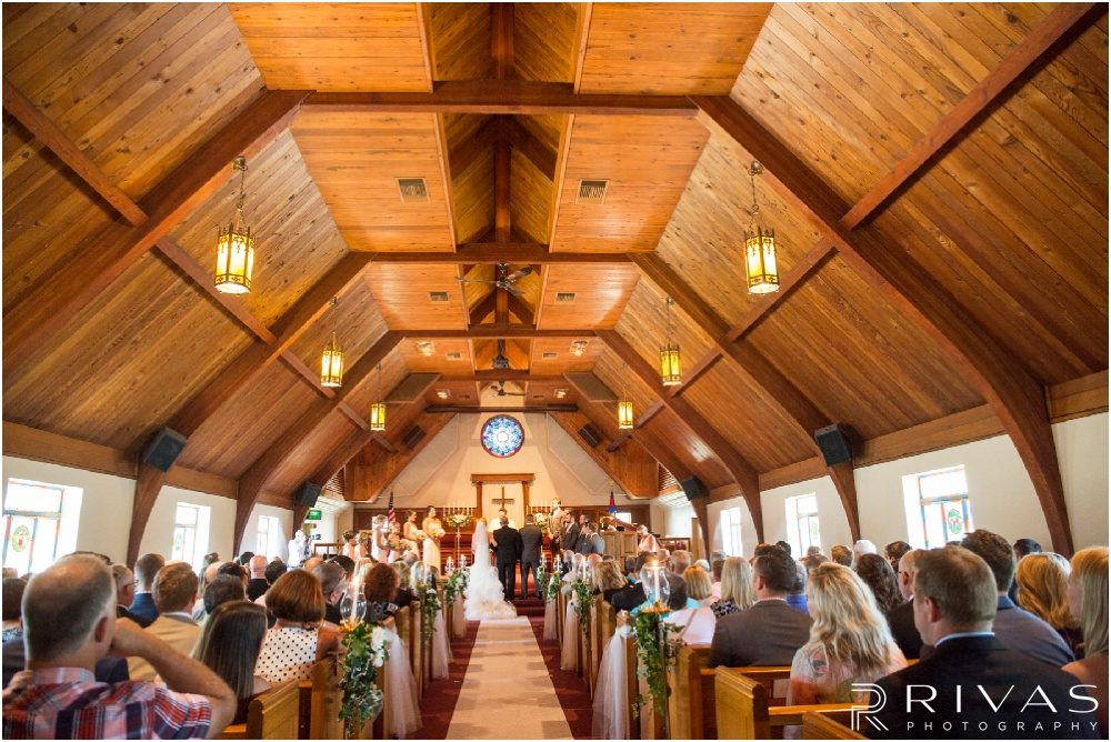Wedding Day Timeline | Photo of a bride's father walking her down the aisle at Ashland Presbyterian Church.