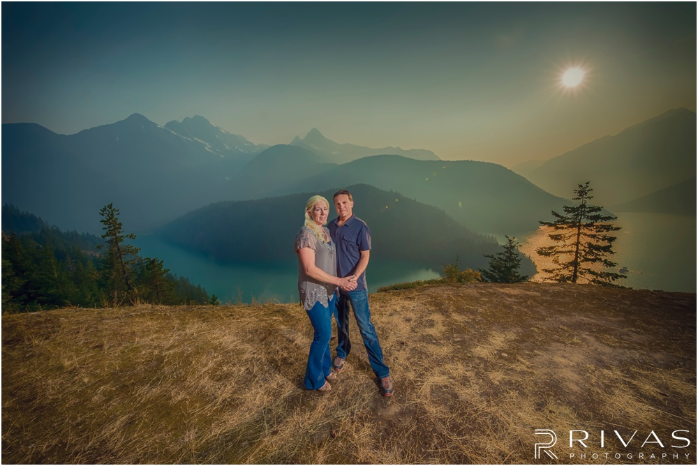 Diablo Lake Engagement Sneak Peek | Photo of an engaged couple looking over smoky Diablo Lake outside of Seattle.