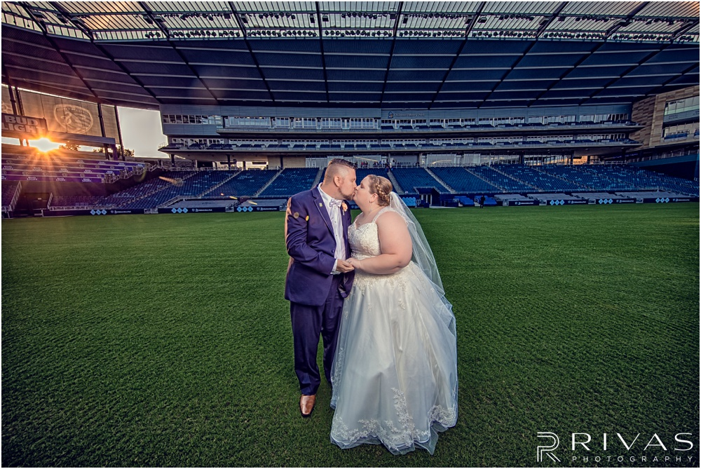 Children's Mercy Park Vow Renewal Sneak Peek | Bride and Groom taking sunset pictures on the pitch at Sporting KC's home stadium, Children's Mercy Park.