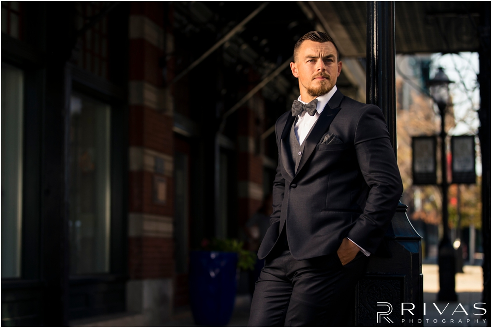 Garment House Styled Bridal Shoot | A picture of a groom modeling a Tip Top Tux Suit outside The Garment House in Kansas City.