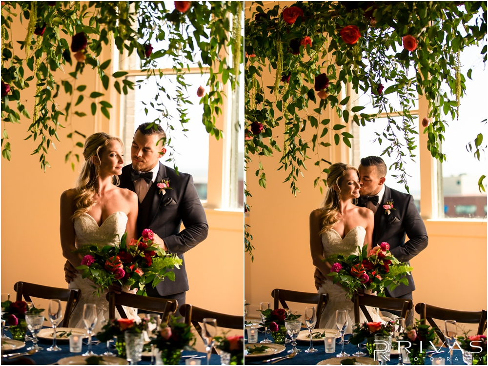 Garment House Styled Bridal Shoot | Two photos of a bride and groom standing in The Garment House underneath a greenery and rose filled garland styled by Hitched in Kansas City.